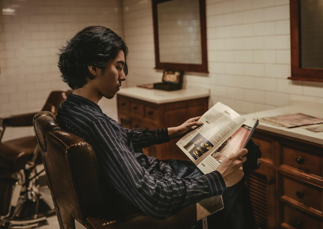 person reading a magazine