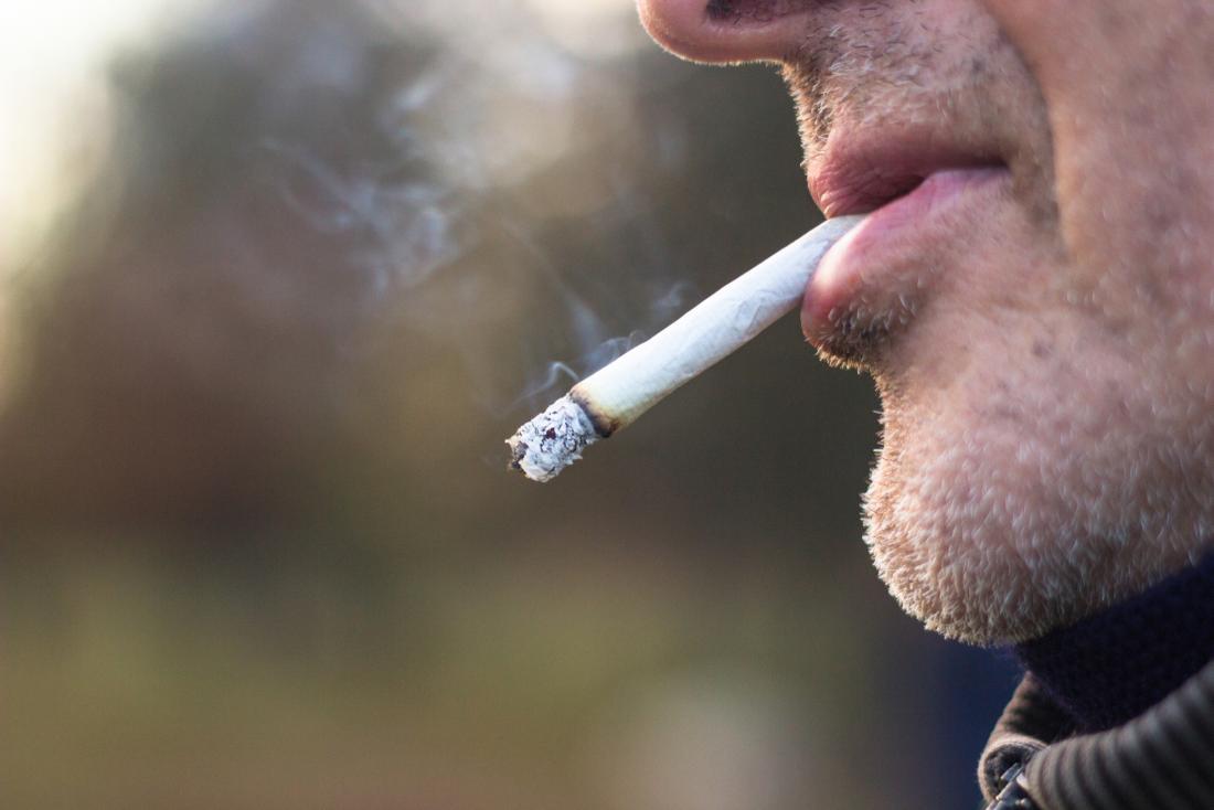 Man smoking close up