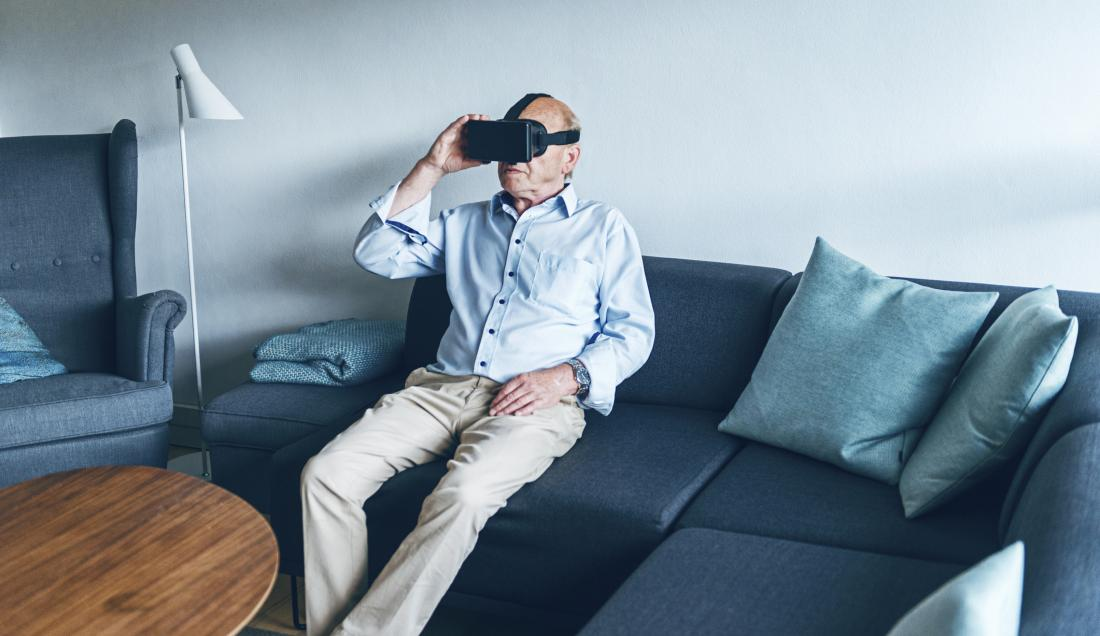 SENIOR Man trying on a VR headset