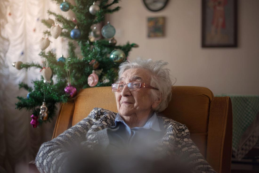 older woman sitting in an armchair