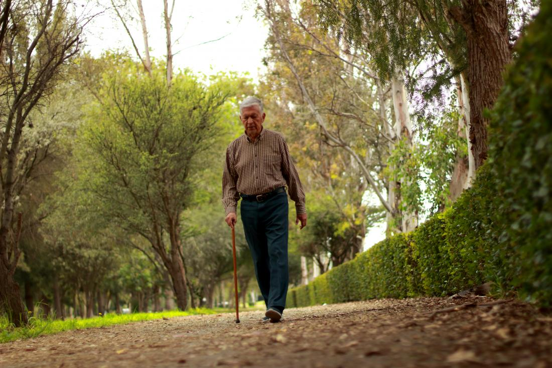 older man walking with cane