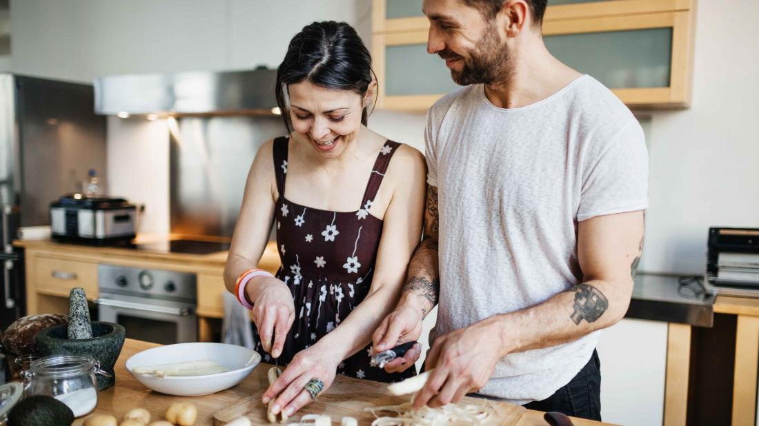 a couple cooking food together for the best diet for mental health