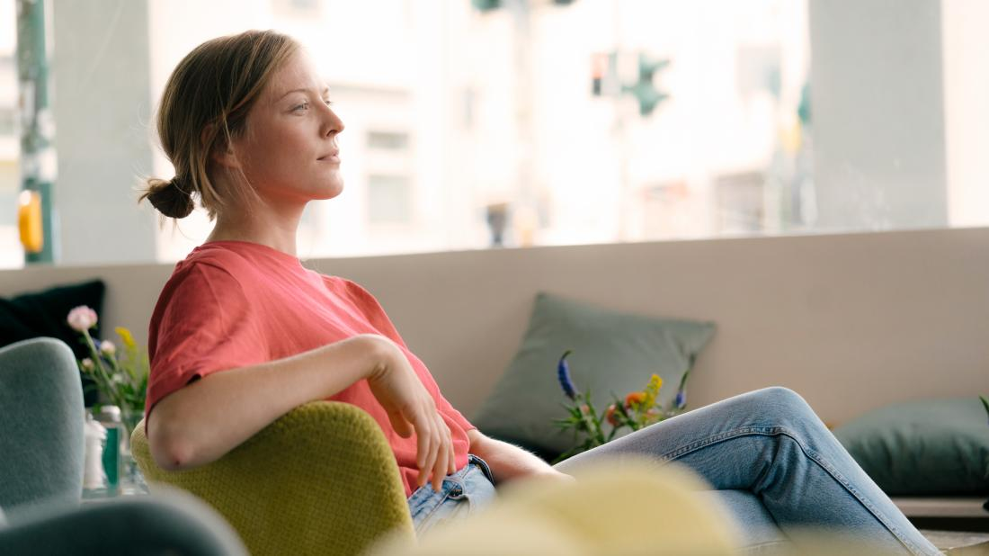a woman sat down as she is feeling spaced out from a Marijuana detox